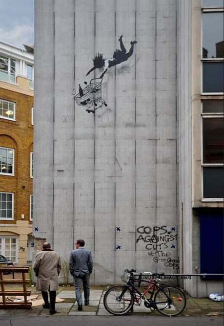 Banksy - Shop till you drop woman and cart in London